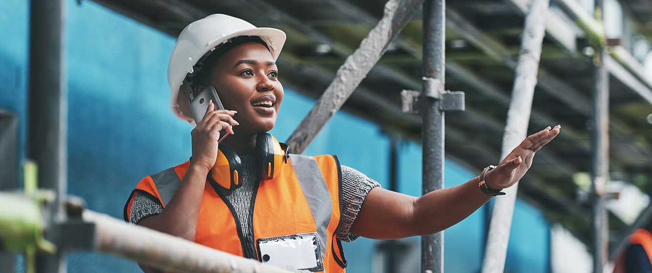 female construction worker on phone